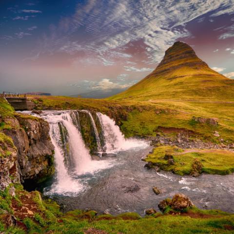 Waterfall next to a mountain
