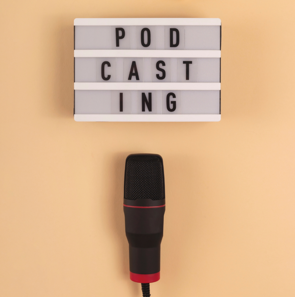 Text says Podcasting with microphone underneath